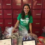 BFKS Committee member Katie Ertel amid a sea of auction items provided by our many business and corporate friends from throughout Berks County